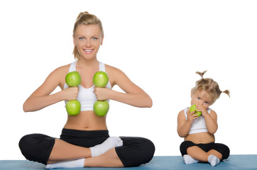 Mom and daughter, fitness dumbbells apples