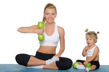 Mother with daughter train weights of apples