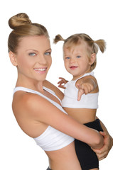 Mother with her daughter in yoga clothes