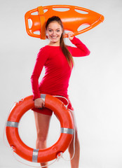 Girl lifeguard with rescue equipment