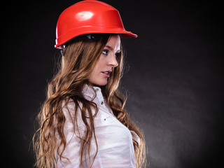 Woman in red helmet.