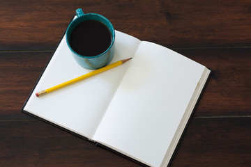 Teal coffee cup full of black coffee