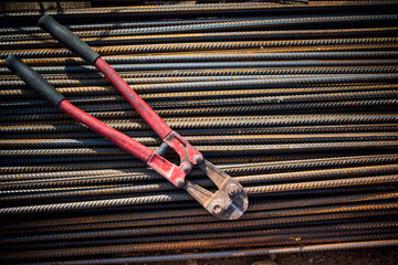 Reinforced steel bars and bolt cutter on construction site
