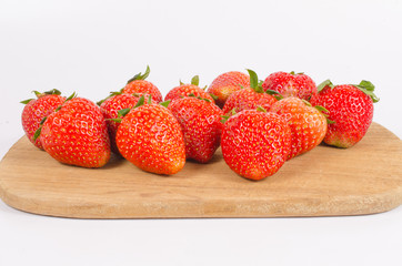 strawberries on wooden board