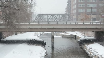 A car going over a bridge in the winter