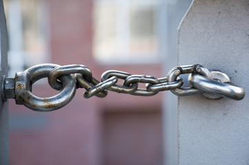 metal chain links two rings, copy space in the blurry background