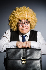 Funny businessman with curly hair