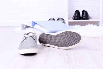 Female sport shoes and briefcase on floor background