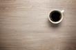 Leinwanddruck Bild - Cup of coffee on desk