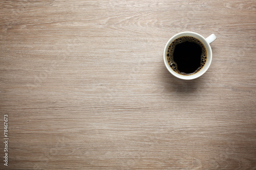 Cup of coffee on desk - 78467673