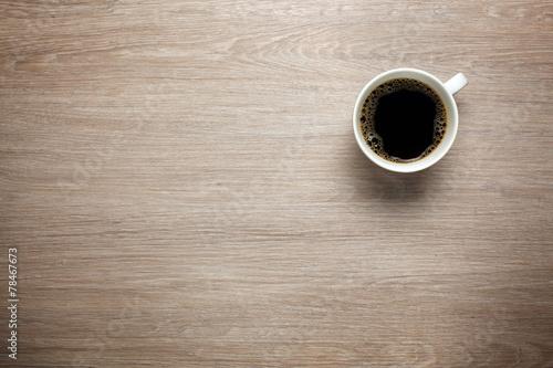 Leinwanddruck Bild Cup of coffee on desk
