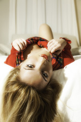 Pretty Blonde Girl In Red Christmas Outfit Hair Off Bed