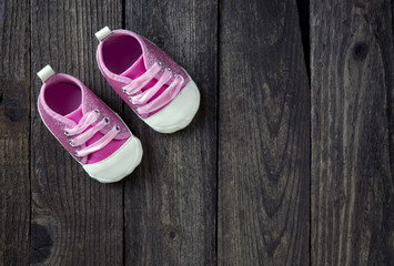 Cute little pink shoes with room for your type.