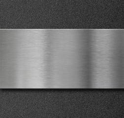 metal panel over black plastic plate