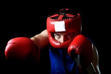 amateur boxer man fighting with boxing gloves and helmet