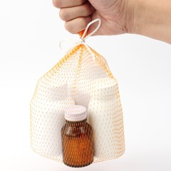 hand hold the net bag medicine bottle