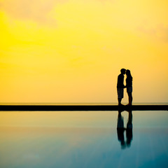 Silhouette of kissing couple in the sunlight