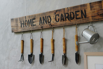 small garden tools hanging on the wall