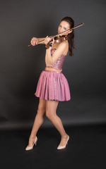 violinist in pink corset