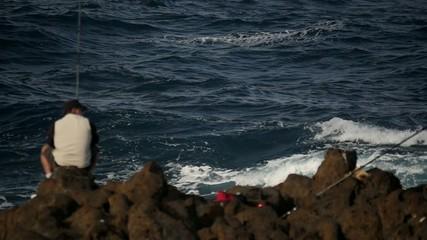 Huge slow motion waves crashing against rocks