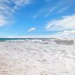 ocean, sandy beach and blue sky