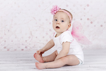 Adorable little baby girl with butterfly wings