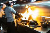 Fototapety Crowded kitchen, a narrow aisle, working chef.