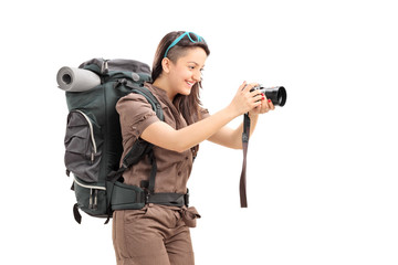 Female tourist taking a picture with a camera