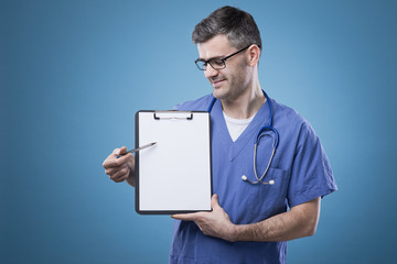 Confident doctor with clipboard