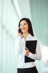 The businesswoman talk by phone in the modern business center