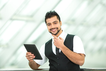 The businessman stand by business center work with the tablet