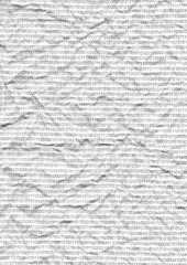 Binary code on a piece of crumpled white paper