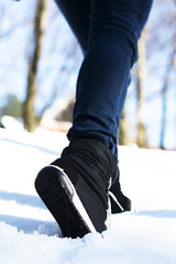 Sport shoes in forest in snow