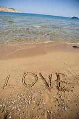 Word love written in sand