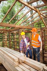 Construction Worker Standing In Wooden Cabin