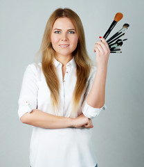 girl makeup with Professional brushes