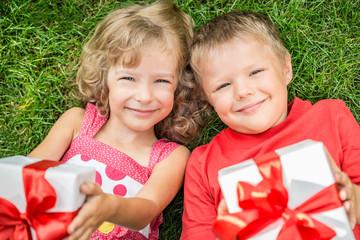 Children holding gift
