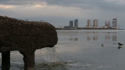 pipe of sewer water from sewerage system directly near sea
