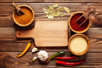Assortment of spices on a wooden table
