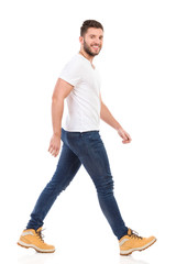 Young man marching in jeans and white t-shirt