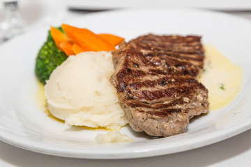 Strip Steak with Mashed Potatoes