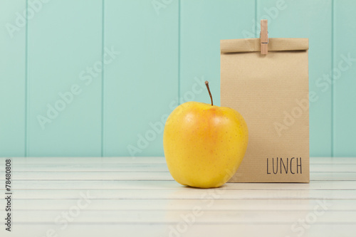 Deurstickers Situatie An apple and a paper bag with lunch. Vintage Style.