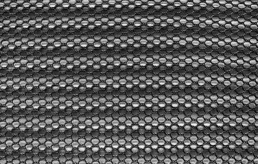 Fishnet cloth material fragment as a texture background