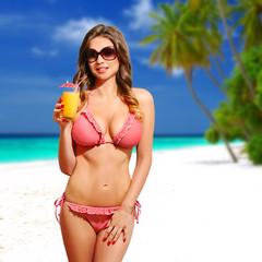 Beautiful woman.  bikini, sunglasses and cocktail, on the beach