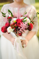 Bride holding a bouquet of beautiful roses