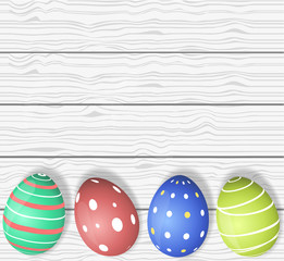 Colourful Easter Eggs wooden background