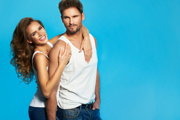 Young couple in white undershirts loving each other