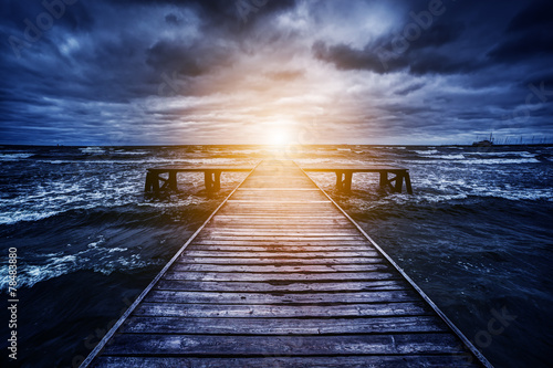 Old wooden jetty during storm on the ocean. Abstract light - 78483880