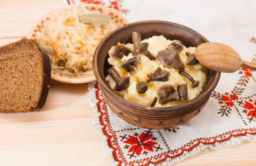 potatoes with mushrooms and sauerkraut on a wooden table, Lenten