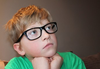 Young pensive boy in glasses